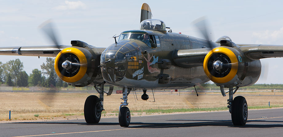 B25 Mitchell Bomber taxiing on runway.